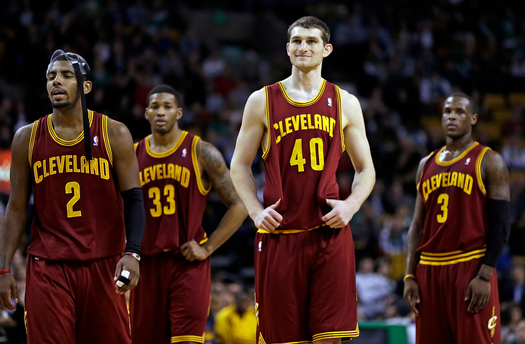. Cleveland Cavaliers guard Kyrie Irving (2), forward Alonzo Gee (33), center Tyler Zeller (40) and shooting guard Dion Waiters (3) react as forward Tristan Thompson, not shown, misses two free throws in the fourth quarter of an NBA basketball game against the Boston Celtics in Boston, Wednesday, Dec. 19, 2012. The Celtics won 103-91. (AP Photo/Elise Amendola)