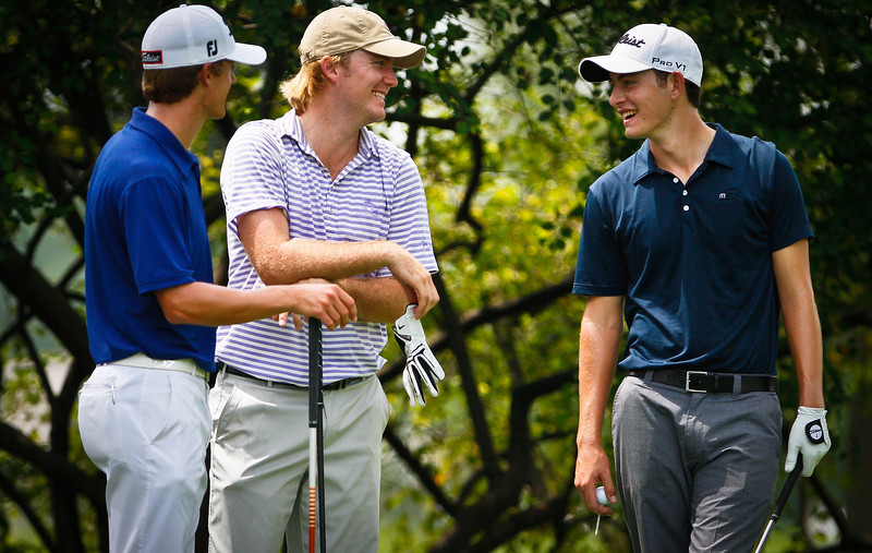 (Left to right) Top ranked amateur golfers Blayne Barber, Russell Henley and Patrick Cantlay talk before teeing off on the 10th hole during the first round Tuesday.