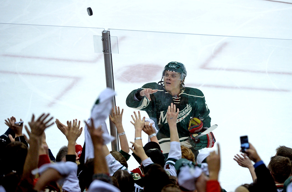 . Minnesota\'s Mikael Granlund throws a puck to fans after their 1-0 win over the Colorado Avalanche.  (Pioneer Press: Sherri LaRose-Chiglo)