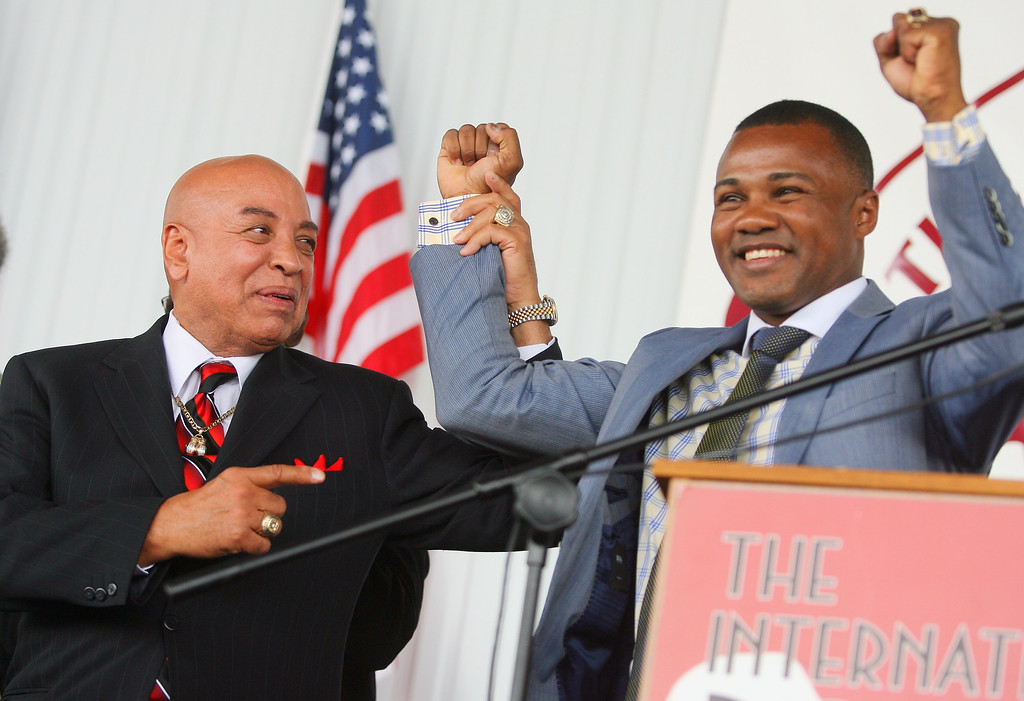 . 2011 International Boxing Hall of Fame referee Joe Cortez holds up the arm of 2014 inductee Felix Trinidad during  the  induction ceremony  at the hall on Sunday, June 8, 2014 in Canastota. JOHN HAEGER-ONEIDA DAILY DISPATCH @ONEIDAPHOTO ON TWITTER