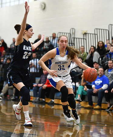 2/18/2020 Mike Orazzi | StaffrBristol Eastern's Jordan Ouellette (33) and East Catholic's Emily Jeamel (22) during a 57-52 Eastern overtime win in Bristol Tuesday afternoon.