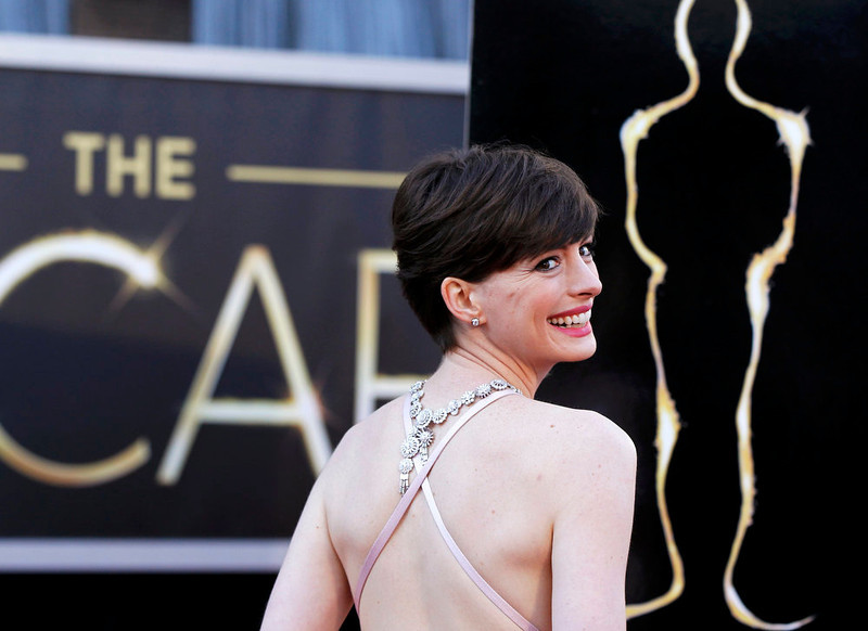 """. Anne Hathaway, best supporting actress nominee for her role in \""""Les Miserables\"""", arrives at the 85th Academy Awards in Hollywood, California February 24, 2013. REUTERS/Lucas Jackson"""