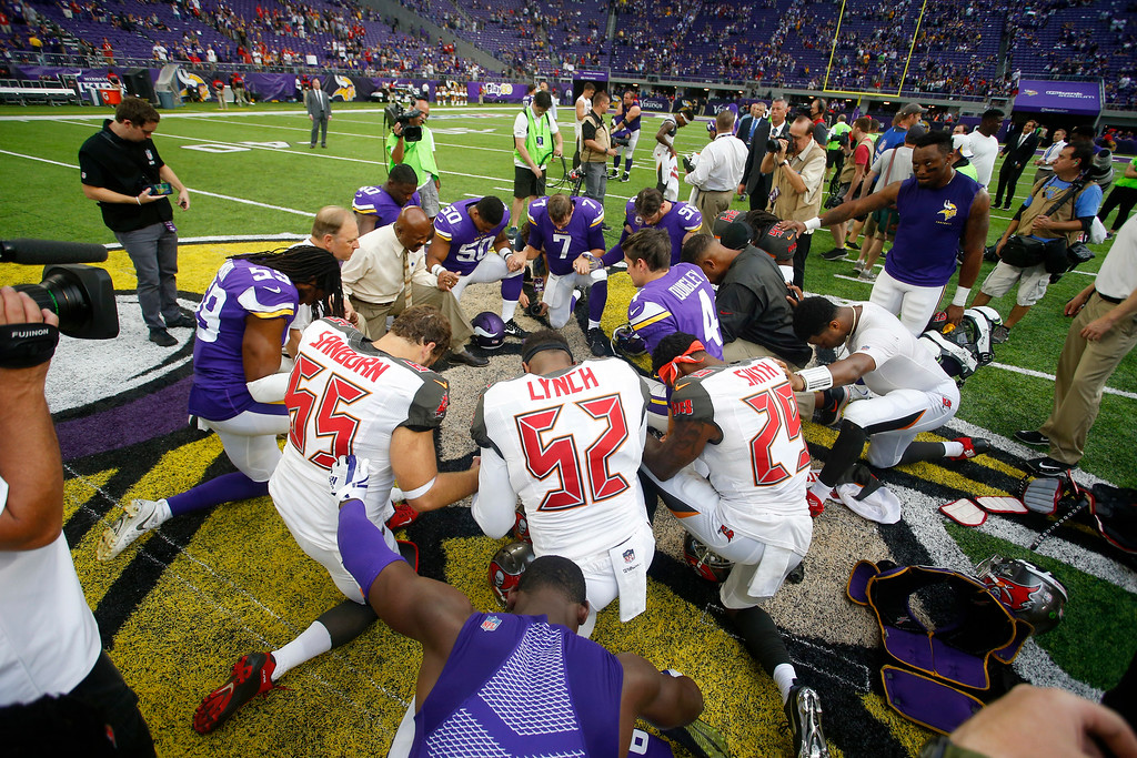. Players huddle on the field after an NFL football game between the Minnesota Vikings and the Tampa Bay Buccaneers, Sunday, Sept. 24, 2017, in Minneapolis. The Vikings won 34-17. (AP Photo/Bruce Kluckhohn)