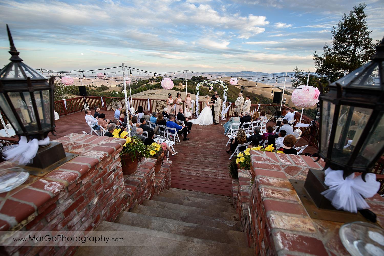 wide view of backyard wedding ceremony