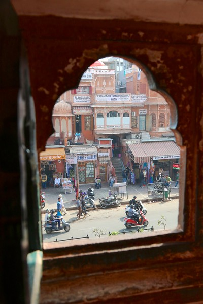 Peeking through one of the hundreds of jharokhas onto the street below - Hawa Mahal, Jaipur