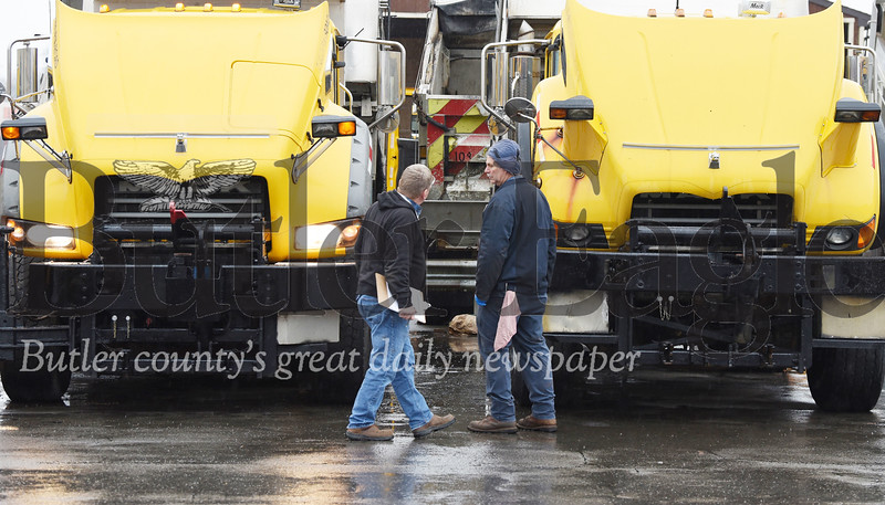 Harold Aughton/Butler Eagle: Tim Clevenger, PennDot equipment manager from Indiana County, inspects the trucks at the Butler PennDot facility, with diesel mechanic Denny Schnitski, Thurs., Nov. 7.