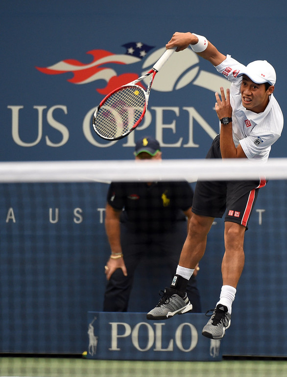 . Kei Nishikori of Japan serves to Marin Cilic of Croatia during their US Open 2014 men\'s singles finals match at the USTA Billie Jean King National Center September 8, 2014  in New York. TIMOTHY A. CLARY/AFP/Getty Images