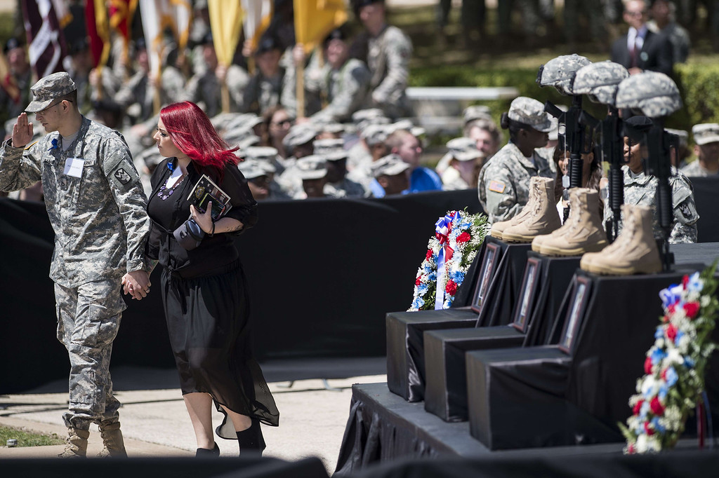 . People arrive for a memorial service at Fort Hood April 9, 2014 in Texas.  AFP PHOTO/Brendan SMIALOWSKI/AFP/Getty Images