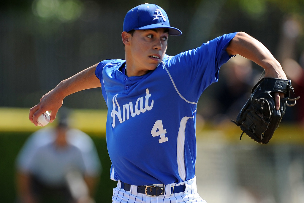 . Bishop Amat starting pitcher Alex Garcia throws to the plate in the first inning of a prep baseball game against St. Paul at Bishop Amat High School on Friday, April 19, 2012 in La Puente, Calif. Bishop Amat won 3-2.    (Keith Birmingham/Pasadena Star-News)