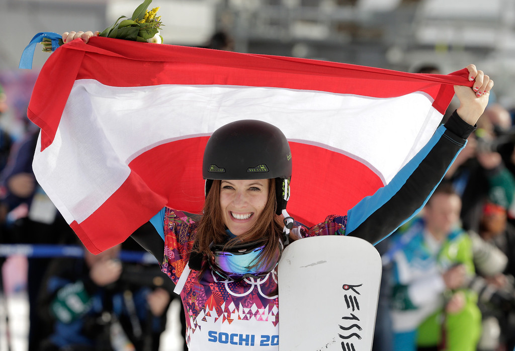 . SOCHI, RUSSIA - FEBRUARY 22:  Julia Dujmovits of Austria celebrates winning the gold medal during the flower ceremony in the Snowboard Ladies\' Parallel Slalom Big Final on day 15 of the 2014 Winter Olympics at Rosa Khutor Extreme Park on February 22, 2014 in Sochi, Russia.  (Photo by Adam Pretty/Getty Images)