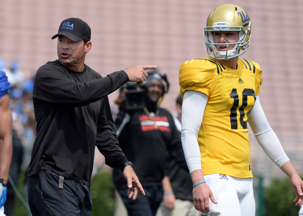 . UCLA Bruins head coach Jim Mora, left, with quarterback Jake Hall (10) during a NCAA college spring football game at the Rose Bowl in Pasadena, Calif., Saturday, April 25, 2015.