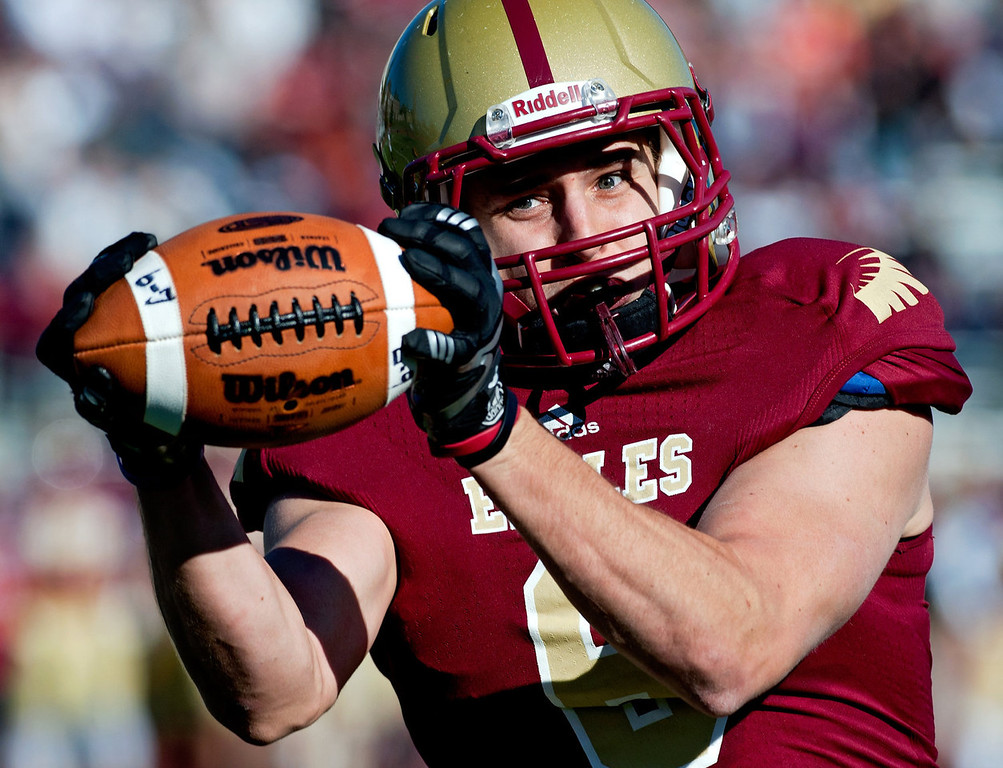 . Bridgewater College wide receiver Cassidy Burns makes a catch during the first half against Randolph-Macon during a football game Saturday, Nov. 9, 2013, in Bridgewater, Va. (AP Photo/Daily News-Record, Jason Lenhart) NO SALES