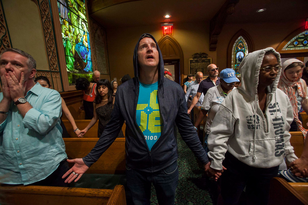 . Worshippers at the Middle Collegiate Church hold prayer services wearing hoodies in support of slain teenager Trayvon Martin in response to the acquittal of George Zimmerman in his trial in New York, July 14, 2013. A Florida jury acquitted Zimmerman on Saturday for the shooting death of unarmed black teenager Martin, setting free a man who had become a polarizing figure in the national debate over racial profiling and self-defense laws. REUTERS/Keith Bedford