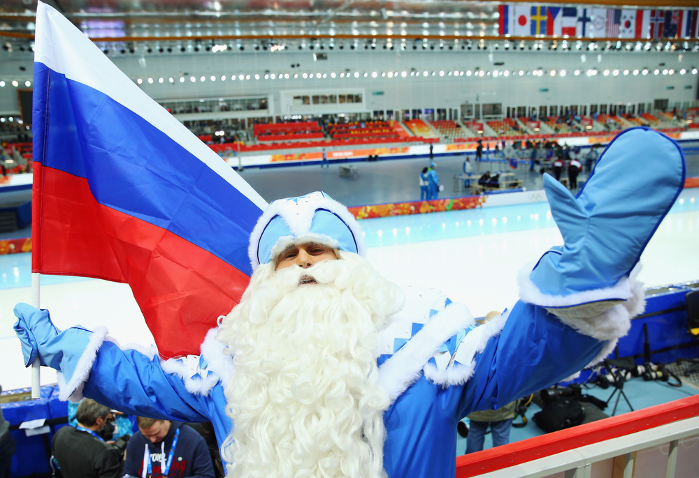 . A fan enjoys the atmosphere ahead of the Men\'s 5000m Speed Skating event during day 1 of the Sochi 2014 Winter Olympics at Adler Arena Skating Center on February 8, 2014 in Sochi, Russia.  (Photo by Quinn Rooney/Getty Images)