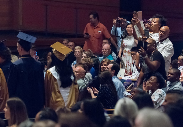 06/21/18 Wesley Bunnell | Staff Families of Newington High School students stand to get a better view of their graduates on Thursday night at the Oakdale Theatre.