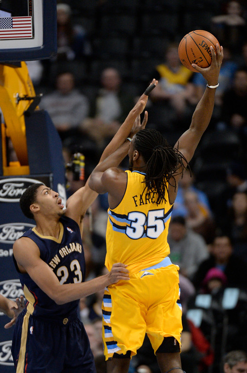 . Denver Nuggets forward Kenneth Faried (35) goes up for a jump hook on New Orleans Pelicans forward Anthony Davis (23) during the first quarter April 2, 2014 at the Pepsi Center in Denver. (Photo by John Leyba/The Denver Post)
