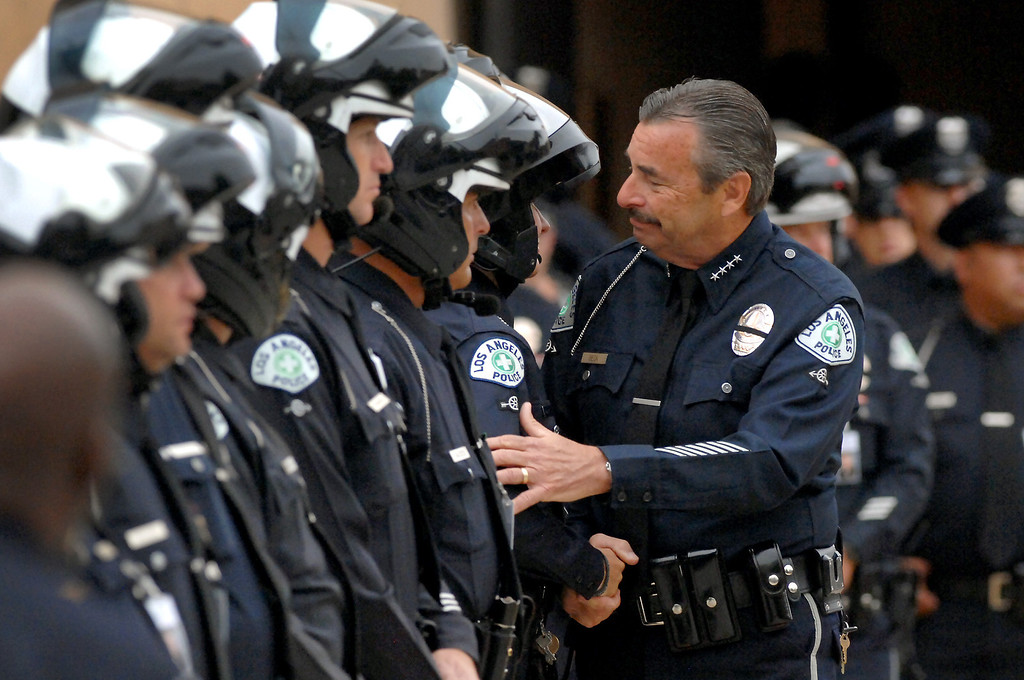. LAPD Chief Charlie Beck greets officers at Cathedral of Our Lady of the Angels, Tuesday, April 22, 2014, for the funeral mass for LAPD motorcycle officer Chris Cortijo. (Photo by Michael Owen Baker/L.A. Daily News)