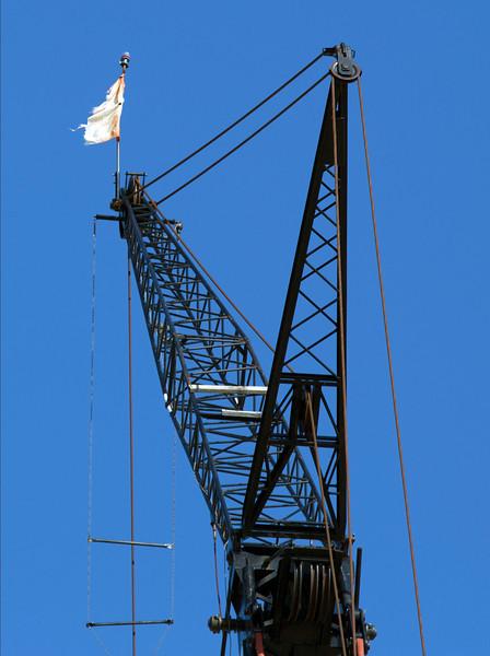 A crane bearing a company flag