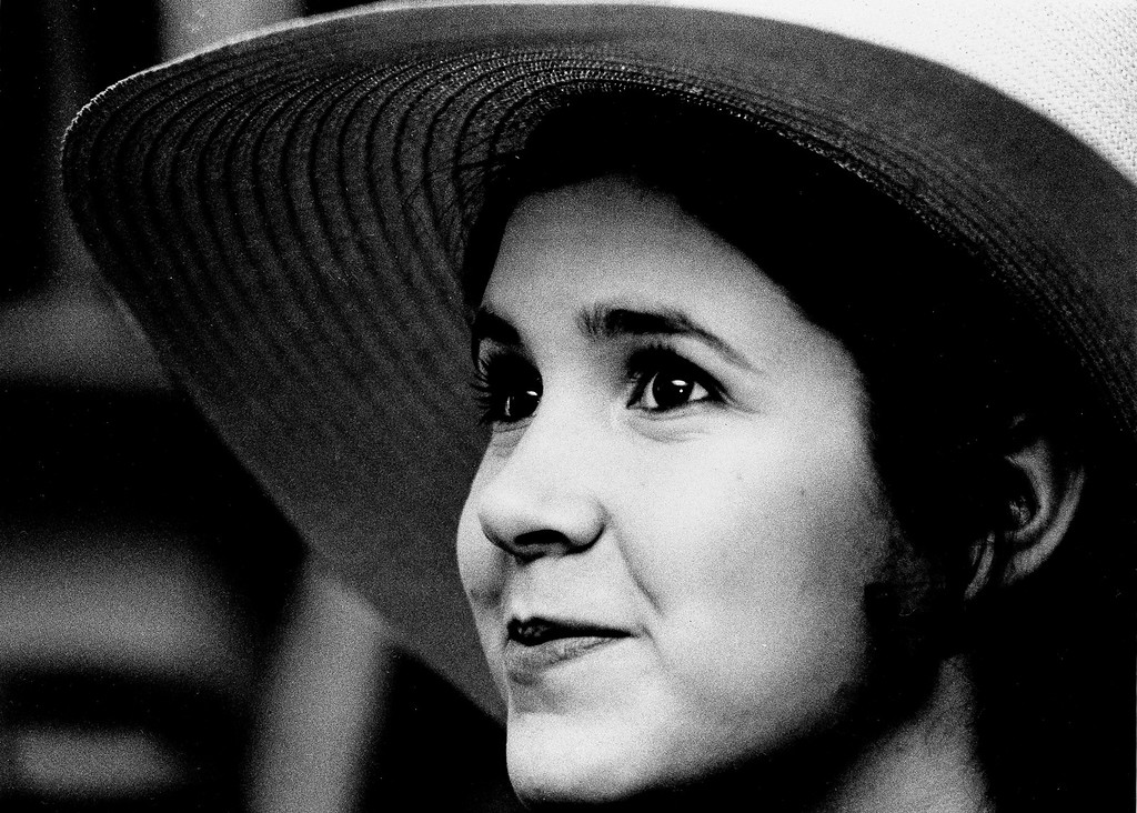 """. Carrie Fisher, 16-year-old daughter of Debbie Reynolds and Eddie Fisher, says it\'s a hassle to be judged as the daughter of celebrities. But being Debbie Reynolds\' daughter admittedly has helped her get her present job in the chorus of \""""Irene,\"""" in which her mother stars on Broadway. She is pictured in New York, May 2, 1973. (AP Photo/Jerry Mosey)"""