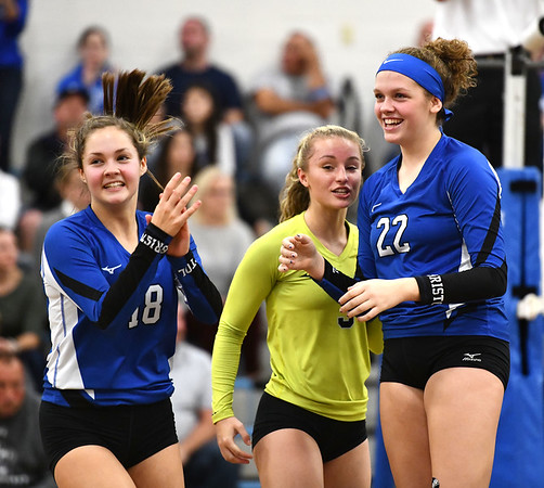10/23/2019 Mike Orazzi | StaffrBristol Eastern's Leah Chipman (18), Rebecca Bender (3) and Hannah Webber (22) celebrate against RHAM during girls volleyball at Bristol Eastern on Wednesday night.