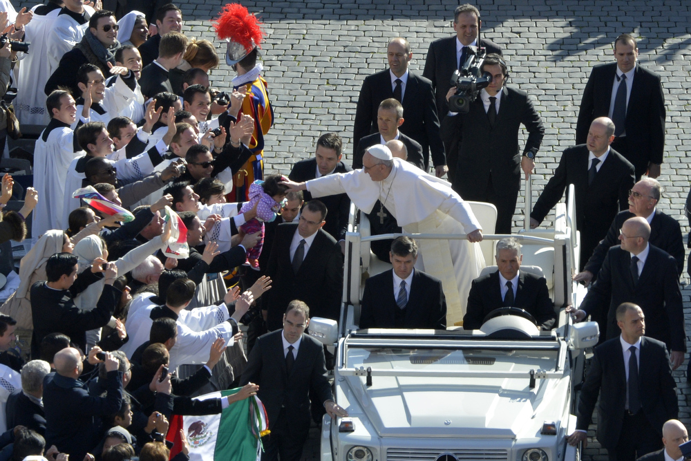 . Pope Francis blesses a baby upon arrival in the papamobile on St Peter\'s square for his inauguration mass on March 19, 2013 at St peter\'s square at the Vatican. Pope Francis swept into St Peter\'s Square on Tuesday to greet throngs of pilgrims before a sumptuous ceremony in which Latin America\'s first pontiff will receive the formal symbols of papal power. ,ANDREAS SOLARO/AFP/Getty Images