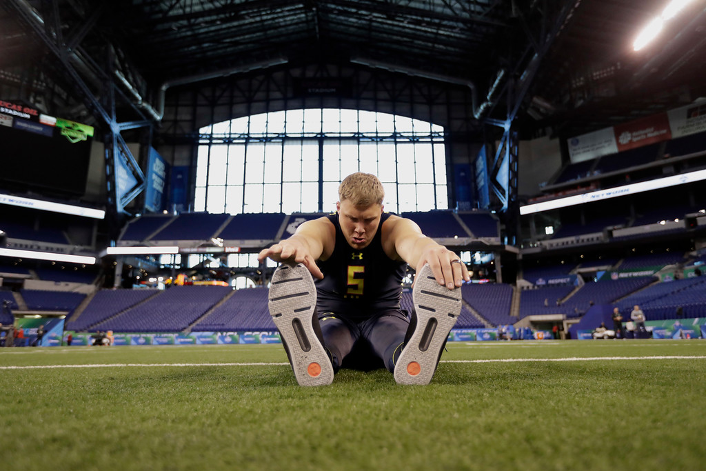 . Utah offensive lineman Garett Bolles stretches at the NFL football scouting combine Friday, March 3, 2017, in Indianapolis. (AP Photo/David J. Phillip)