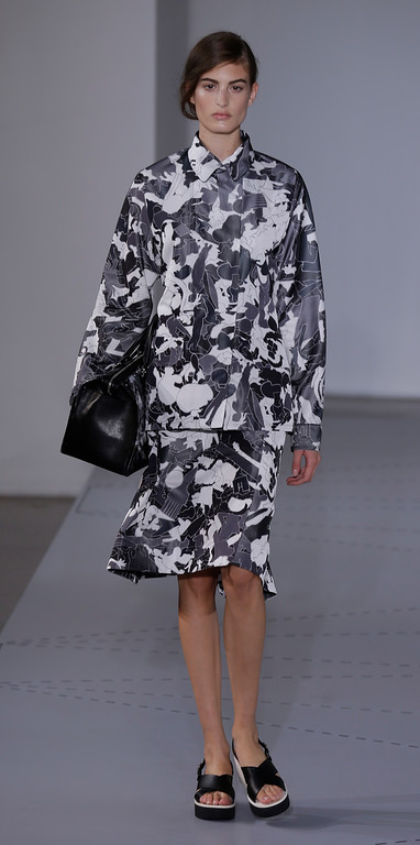 . A model wears a creation for Jil Sander women\'s Spring-Summer 2014 collection, part of the Milan Fashion Week, unveiled in Milan, Italy, Saturday, Sept. 21, 2013. (AP Photo/Luca Bruno)