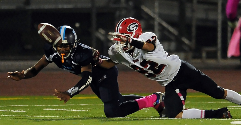 . Duarte\'s Darryl Robinson (5) knocks away a pass intended for Gladstone\'s Manny Mendez (22) in the first half of a prep football game at Duarte High School in Duarte, Calif., Thursday, Oct. 10, 2013.    (Keith Birmingham Pasadena Star-News)