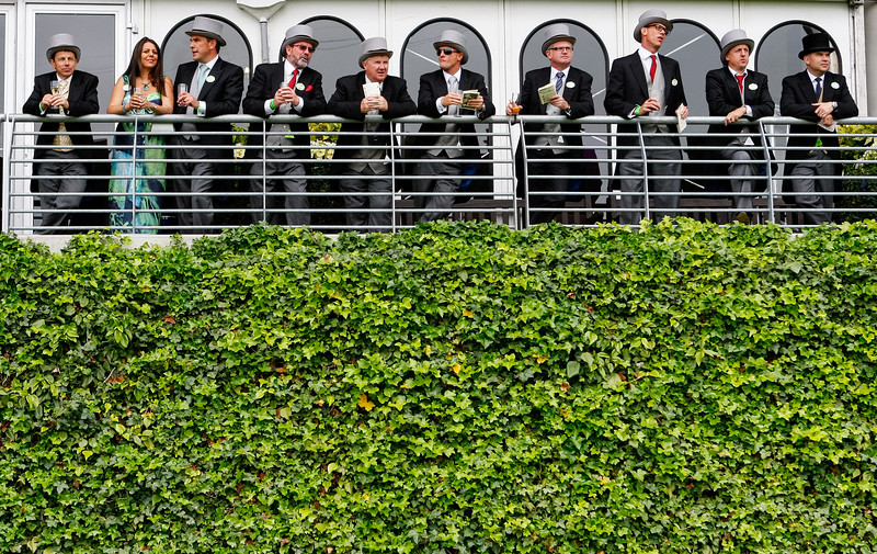 Racegoers watch the action during Royal Ascot