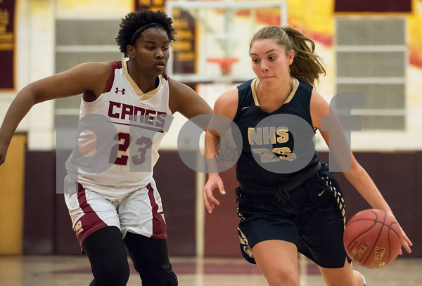 01/08/18 Wesley Bunnell | Staff New Britain basketball was defeated by Newington on Monday evening at New Britain High School. Tianna Sweeney (23) and Maya Gajowiak (23).