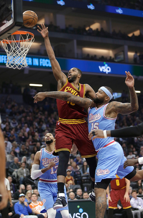 . Cleveland Cavaliers center Tristan Thompson, center, goes to the basket against Sacramento Kings forward DeMarcus Cousins, right, during the first quarter of an NBA basketball game Friday, Jan. 13, 2017, in Sacramento, Calif. (AP Photo/Rich Pedroncelli)