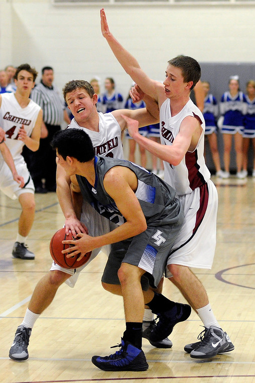 . LITTLETON, CO. - MARCH 6: Legend senior Jonathon Cosmann (23) struggled with the Chargers double team in the second half. The Legend High School boy\'s basketball team upset Chatfield 51-49  in a playoff game Wednesday night, March 6, 2013. (Photo By Karl Gehring/The Denver Post)