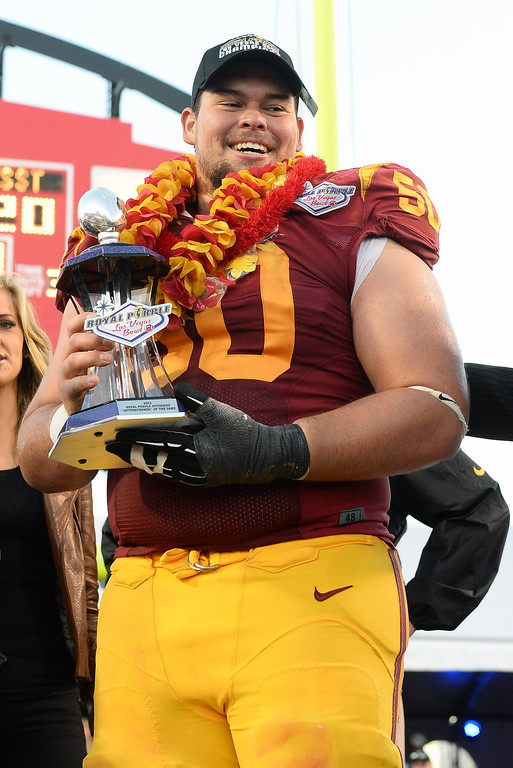 ". LAS VEGAS, NV - DECEMBER 21:  Abe Markowitz #50 of the USC Trojans holds the Offensive ""Outperformer\"" of the Game award after the team defeated the Fresno State Bulldogs 45-20 to win the Royal Purple Las Vegas Bowl at Sam Boyd Stadium on December 21, 2013 in Las Vegas, Nevada.  (Photo by Ethan Miller/Getty Images)"