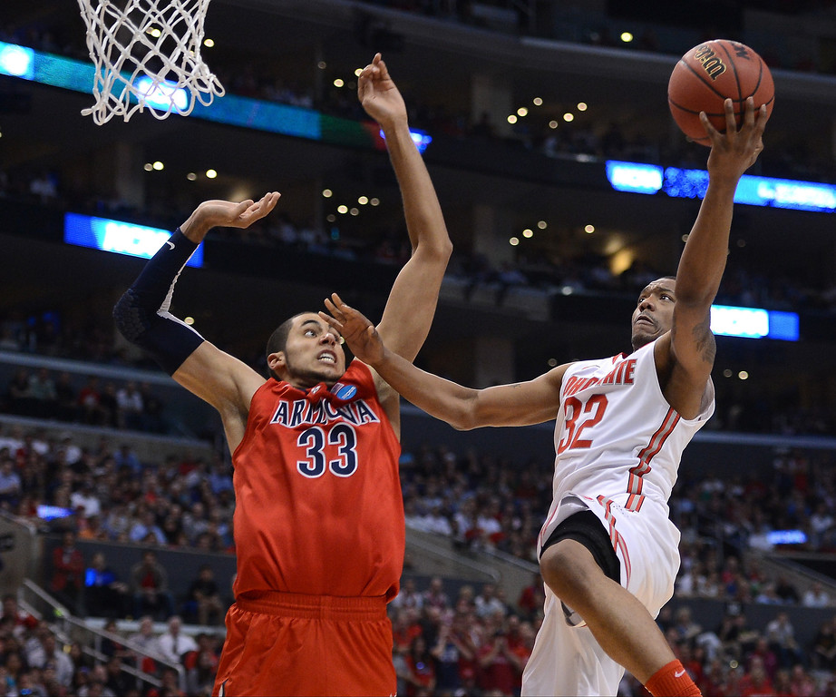 . Lenzelle Smith Jr. #32 of the Ohio State Buckeyes goes up for a shot against Grant Jerrett #33 of the Arizona Wildcats in the second half during the West Regional of the 2013 NCAA Men\'s Basketball Tournament at Staples Center on March 28, 2013 in Los Angeles, California.  (Photo by Harry How/Getty Images)