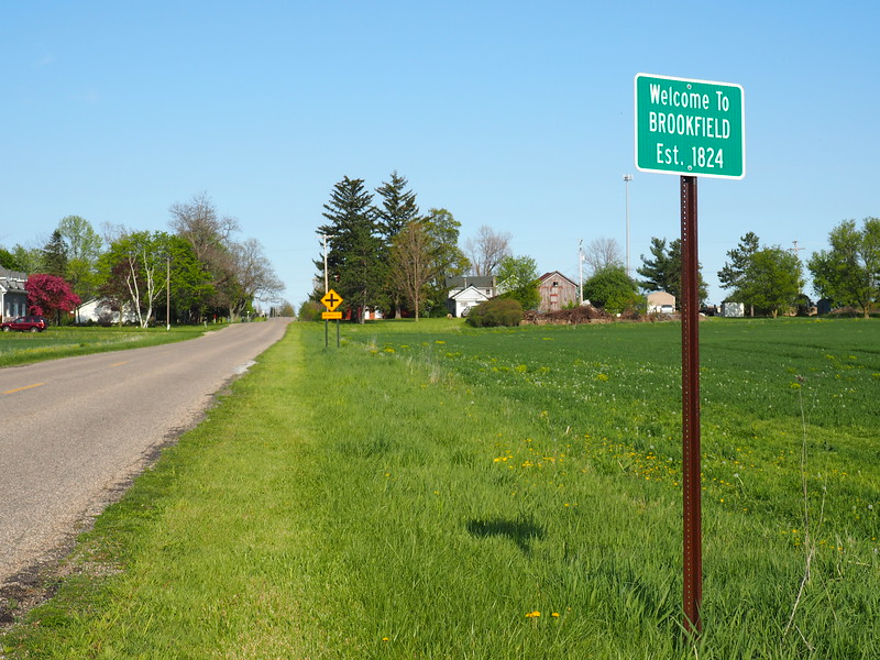 Entering Brookfield from the west. To get to the township hall, turn right at the intersection.  It's the second building on the left.