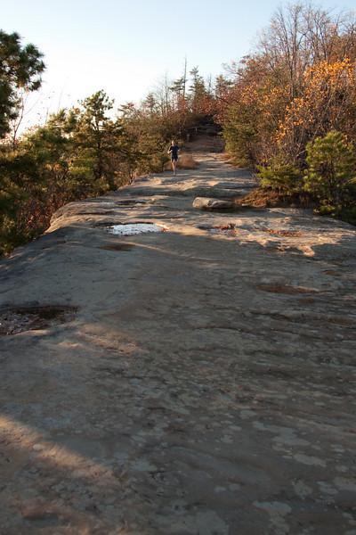 Ross running along natural bridge