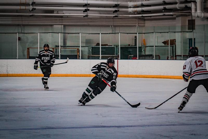Holy Family Boys Varsity Hockey vs. Elk River, 12/27/19: Jacob McPartland '21 (12)
