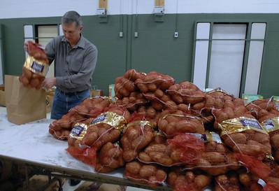 Lions club members help feed needed families