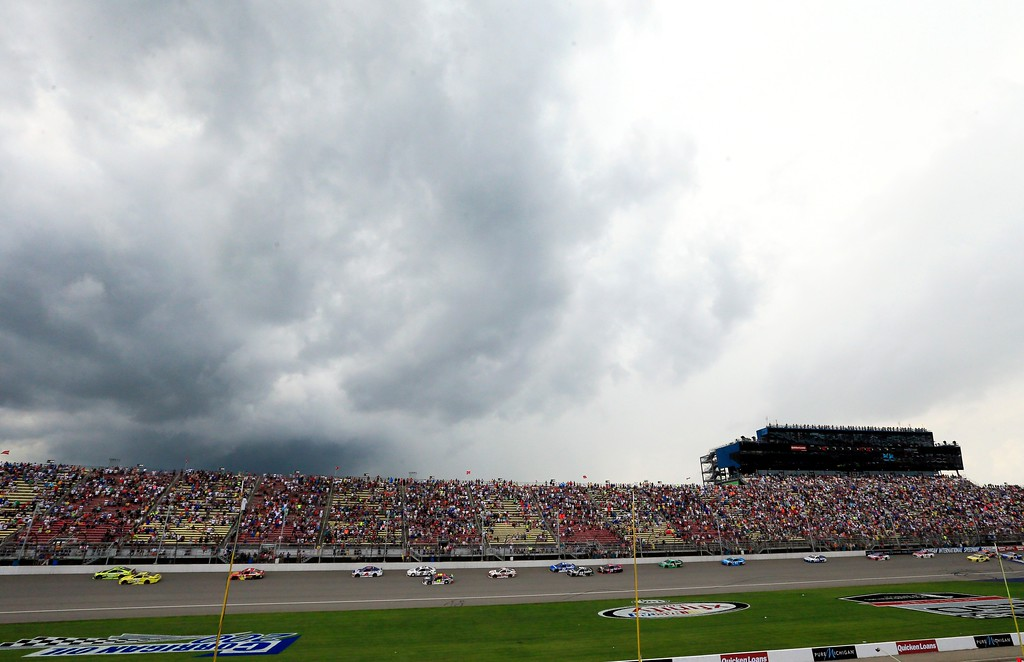 . Storm clouds approach Michigan International Speedway during the NASCAR Sprint Cup series auto race, Sunday, June 14, 2015, in Brooklyn, Mich. (AP Photo/Carlos Osorio)