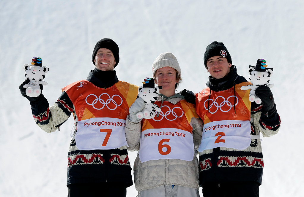 . From left: Silver medal winner Max Parrot, of Canada (7), gold medal winner Red Gerard, of the United States (6), and Bronze medal winner Mark McMorris, of Canada, stand during the medal recognition ceremony after the men\'s slopestyle final at Phoenix Snow Park at the 2018 Winter Olympics in Pyeongchang, South Korea, Sunday, Feb. 11, 2018. (AP Photo/Lee Jin-man)