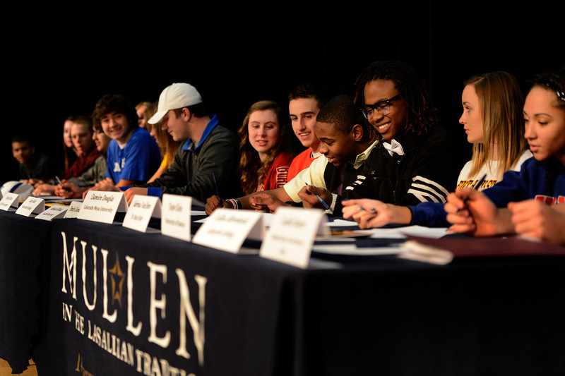 . College signing day for Tim Coleman to go to Colorado University (4th from right) with 16 other students signing their letter of intent at Mullen High School in the Rilko Event Center on Mullen campus February 6, 2013 Denver, Colorado. (Photo By Joe Amon/The Denver Post)