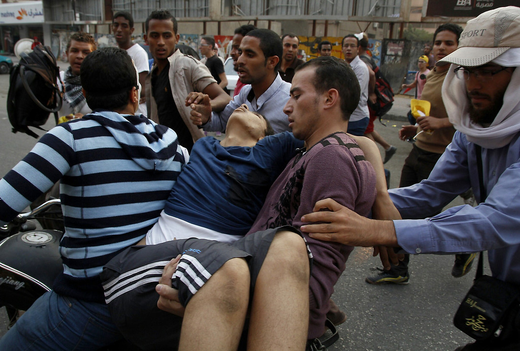 . Supporters of Egyptian ousted president Mohamed Morsi carry an injured comrade in Cairo\'s eastern Nasr City district on October 11, 2013, after clashes broke out during a demonstration against the military. An Islamist alliance urged its supporters to stay away from Cairo\'s Tahrir Square during protests to avoid more bloodshed after a week in which nearly 80 Egyptians were killed. MOHAMED ABDELMENIEM/AFP/Getty Images