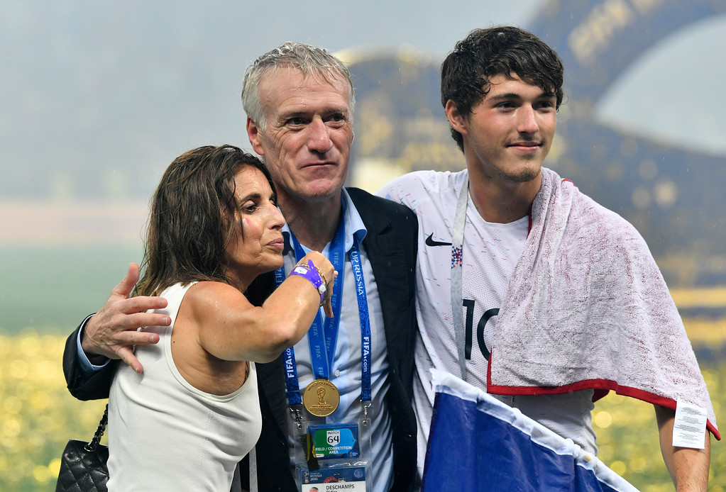 . France head coach Didier Deschamps, center, celebrates with his son Dylan and his wife Claude, left, after France won 4-2 during the final match between France and Croatia at the 2018 soccer World Cup in the Luzhniki Stadium in Moscow, Russia, Sunday, July 15, 2018. (AP Photo/Martin Meissner)