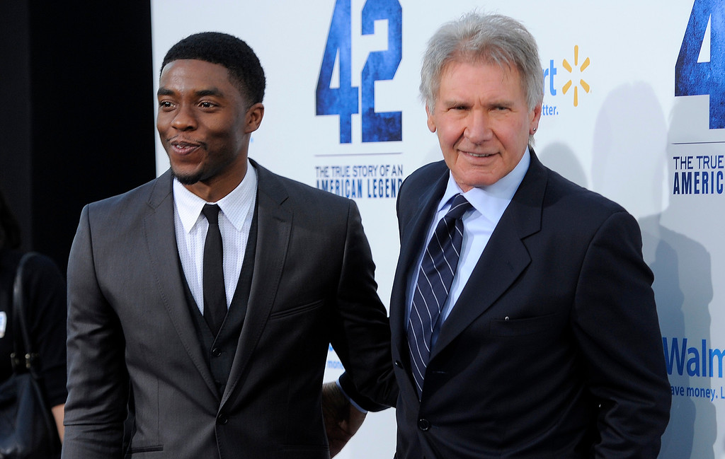 ". Chadwick Boseman, left, who plays Jackie Robinson in ""42,\"" poses with fellow cast member Harrison Ford at the Los Angeles premiere of \""42\"" at the TCL Chinese Theater on Tuesday, April 9, 2013 in Los Angeles. (Photo by Chris Pizzello/Invision/AP)"
