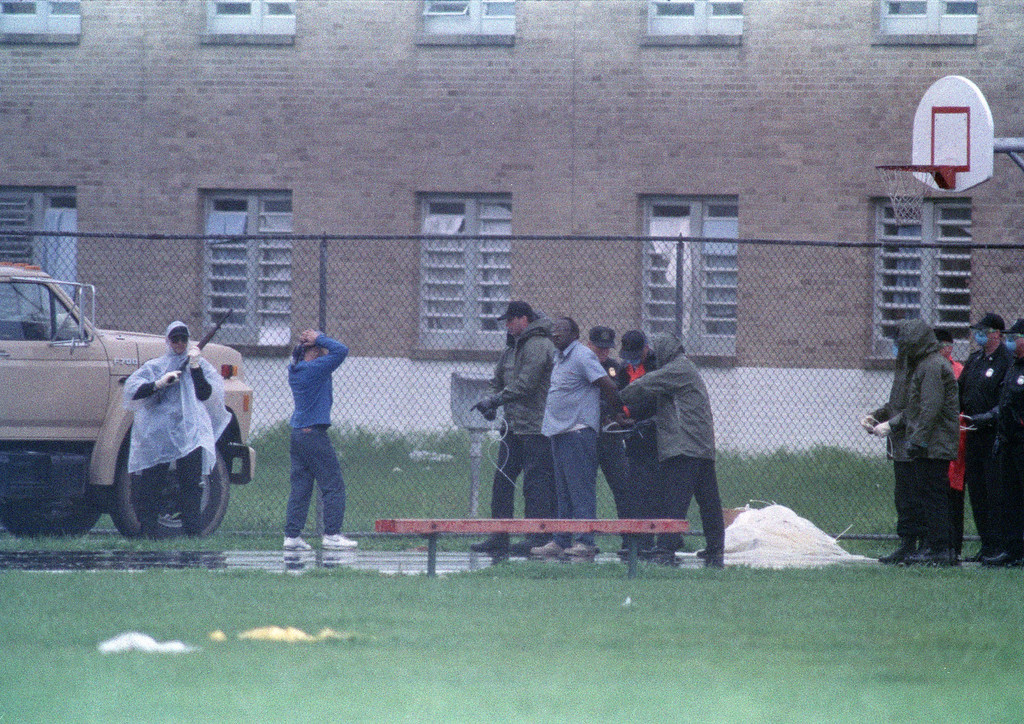. Surrendering inmates are handcuffed with plastic straps after exiting the Southern Ohio Correctional Facility cell block they\'ve occupied for 10 days. in Lucasville, Ohio, April 21, 1993. One guard and seven inmates have died in the uprising. (AP Photo/Lennox McLendon)