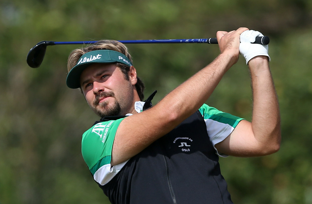 . Victor Dubuisson of France plays a shot off the 8th tee during the final round of the British Open Golf championship at the Royal Liverpool golf club, Hoylake, England, Sunday July 20, 2014. (AP Photo/Jon Super)