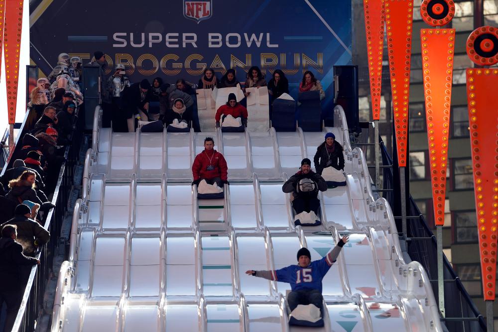 Description of . Super Bowl XLVlll fans take a turn on the Super Bowl Tobogoggan Run to enjoy the Super Bowl Boulevard. The NFL transformed a portion of Broadway into the sports and entertainment hub of Super Bowl Week, January 29, 2014. (Photo by John Leyba/The Denver Post)