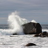 Waves breaking on a large rock