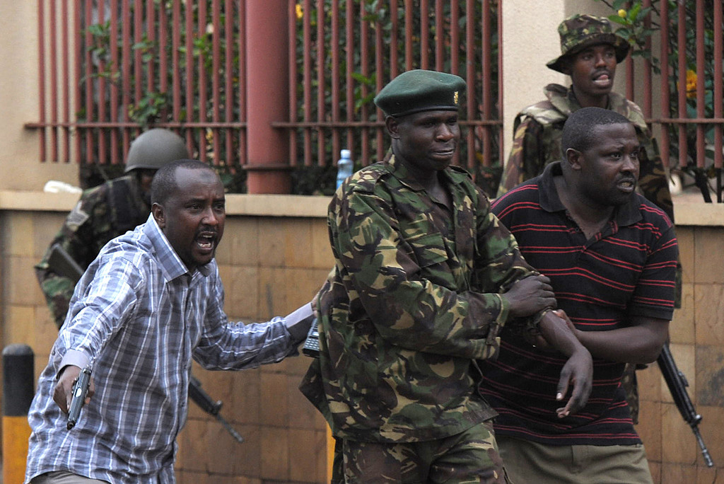 . An injured policeman is evacuated by his colleagues on September 21, 2013 after he was shot during a security operation at an upmarket shopping mall in Nairobi where suspected terrorrists engaged Kenyan security forces in a drawn out gun fight. Some 20 people have been killed and about 50 wounded Saturday in the initial attack by the gunmen the Kenya Red Cross said.  AFP PHOTO / Tony  KARUMBA/AFP/Getty Images