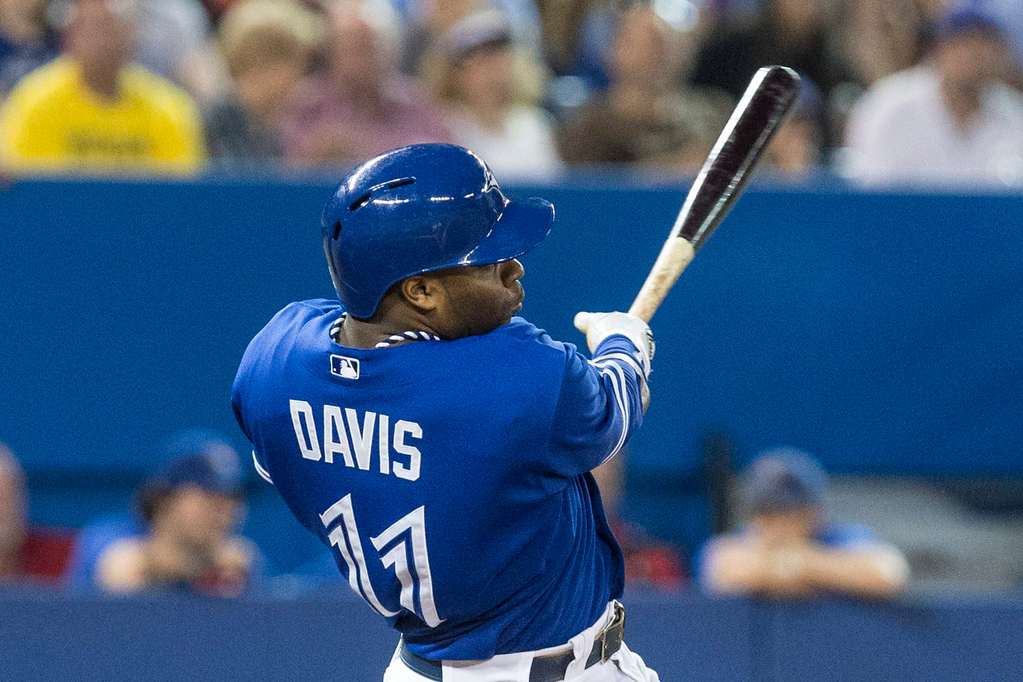 . Toronto\'s Rajai Davis hits a three-run home run off Twins starter Scott Diamond during the fifth inning. (AP Photo/The Canadian Press, Chris Young)
